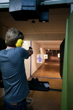 Man at Indoor Shooting Range